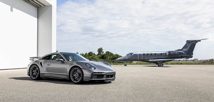 The Phenom 300E light jet and Porsche 911 Turbo S sports car