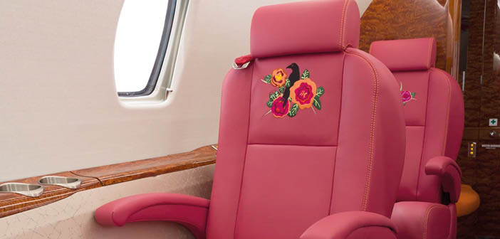 The seats were reupholstered with colourful leather and an embroidered raven detail