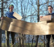 Johannes Steindl and Patrick Domnanich of F/List show an organo sheet made from flax fibres and biopolymer, as well as two lightweight panels based on the new technology