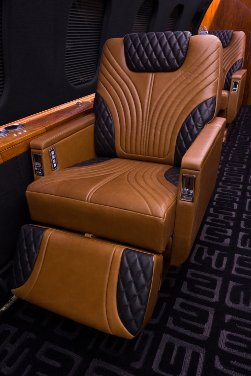 The seat design combines brown and black leather